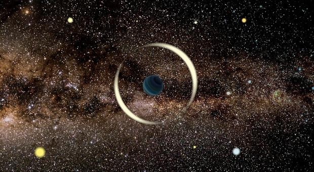 Scoperto nella Via Lattea un pianeta simile alla Terra: è senza stella (Rappresentazione artistica di un evento di microlensing gravitazionale di un pianeta interstellare. Crediti: Jan Skowron / Astronomical Observatory, University of Warsaw)